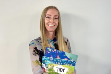 Picture of Louise holding children's books